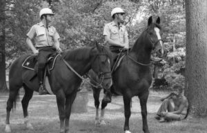Two mounted cops overlook a cautious hipster in this 1971 scene in Piedmont Park