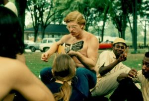 A bare chested guitarist performs an impromptu concert in Piedmont Park to an appreciative audience in March, 1974.