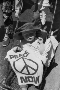 Dig the peace babe at the big antiwar march in May 1970. And the little boonie-hatted one is actually flashing the power fist! Groove upon groove.