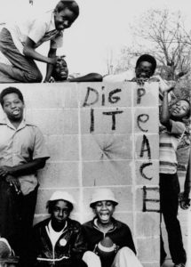 "Kids from Emmaus House youth group at entrance of Four Corners Park, 1971. The kids were members of ""Among Ourselves"" mentored by Gene Ferguson, a lanky black activist who served as youth director of the Episcopal Church-sponsored community center and chapel."